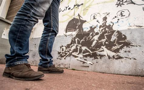 Banksy mural in Calais painted over because wall's owner