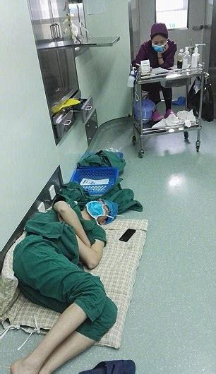 Hero Surgeon Passes Out On Hospital Floor After 28 Hour Shift