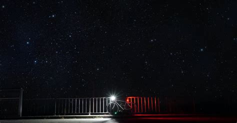 Bicycle With Light Parked Under Starry Sky · Free Stock Photo